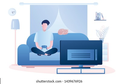 Young man is sitting on the couch. Male is holding a controller and playing a game on TV.Living room interior with furniture. Teen character in trendy style. Vector illustration