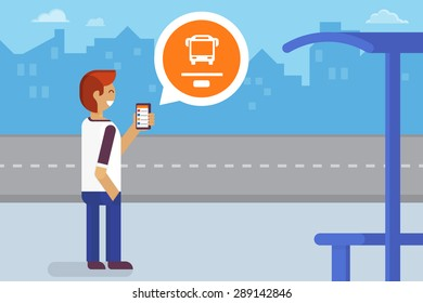 Young man staying on the bus stop and using mobile app for traffic tracking