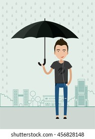 Young man  with an umbrella in a big city