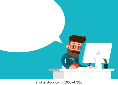 young man working on computer with speech bubble.