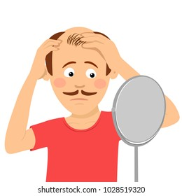 Young man worried about hair loss checking his hair in mirror isolated on white background