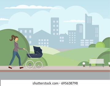 Young mother walking with baby carriage. The pleasant walking with little child. The pram for walking with baby on the open air. Little kid on a walk with mother.