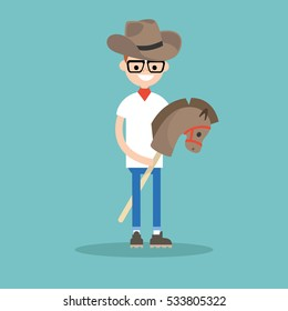 Young nerd wearing cowboy hat and riding hobbyhorse / flat editable vector illustration