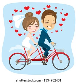 Young newlywed couple riding on tandem bicycle just married concept