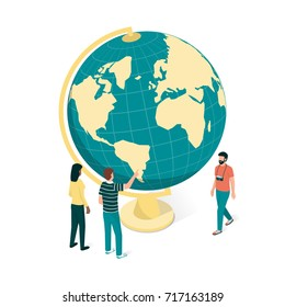 Young people planning a journey around the world, they are pointing at the globe, travel and tourism concept