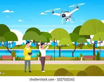 Young People Playing With Drone Copter In Park Man And Woman Using Remote Controller For Quadrocopter Flat Vector Illustration