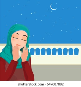 Young Religious Muslim Woman Praying Namaz (Islamic Prayer) in night.