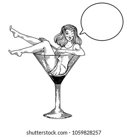 Young sexy beauty woman sit on high martini cocktail glass engraving vector illustration. Scratch board style imitation. Text bubble. Black and white hand drawn image.