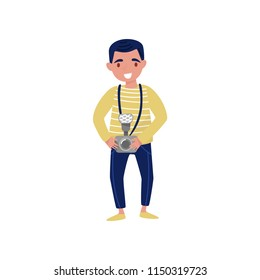 Young smiling man with camera in hand. Professional at work. Cartoon character of photojournalist. Flat vector design