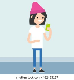 Young teenage girl is looking at her smart phone's screen / editable vector illustration