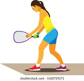 Young teenage girl in yellow top and blue shorts is an athlete who plays racquetball