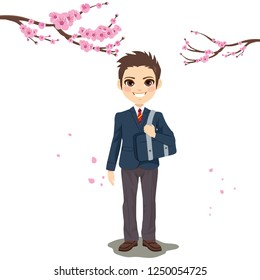 Young uniform student boy with sakura cherry tree on background celebrating new school year