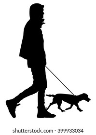 Young urban man walking dog vector silhouette illustration isolated on white background.