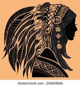 Young woman in costume of American Indian. Silhouette of beautiful Indian women