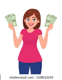 Young woman holding cash/money in hands. Cheerful young woman holding currency notes.