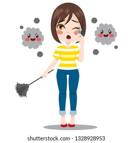 Young woman holding duster cleaning suffering dust allergy reaction