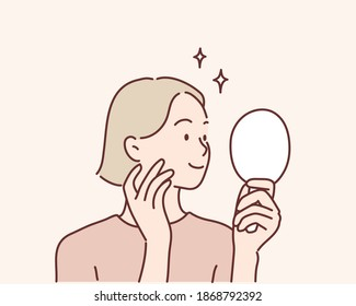 Young woman looking at mirror at home. Hand drawn style vector design illustrations.