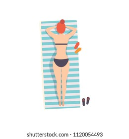 Young woman lying on her stomach on the beach towel and sunbathing on the beach, top view vector Illustration on a white background