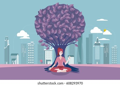 Young woman meditating with crossed legs in front of a tree.