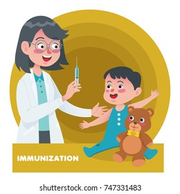 Young woman pediatrician performs a vaccination of a little boy. The boy is holding a mascot.