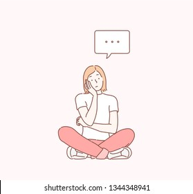 Young woman sitting on the floor thinking. Hand drawn style vector design illustrations.