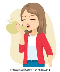 Young woman suffering halitosis bad breath health problem