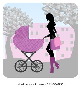 Young woman walking in park with stroller