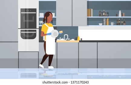 young woman washing dishes african american girl wiping plates dishwashing concept housewife doing housework modern kitchen interior flat horizontal full length