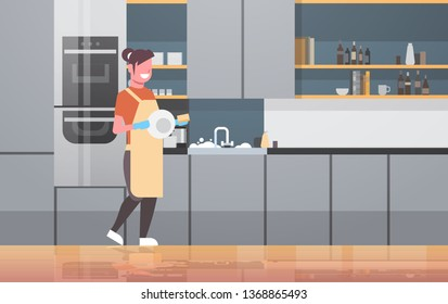 young woman washing dishes smiling girl wiping plates modern kitchen interior dishwashing concept housewife doing housework flat horizontal full length