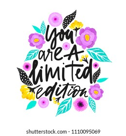 Yuo are a limited edition. Handdrawn illustration. Positive quote made in vector.Motivational slogan. Inscription for t shirts, posters, cards. Floral digital sketch style design. Flowers around.