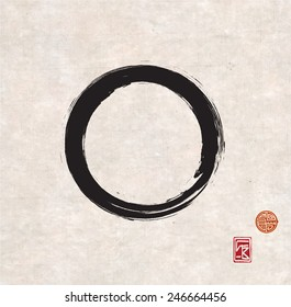 Zen circle on vintage rice paper with decorative stamps. Black circle hand-drawn with ink.