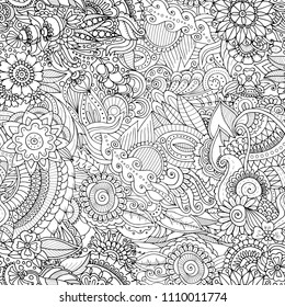 Zentangle black and white ethnic seamless pattern with mandala elements, fantasy flowers and plants in adult coloring book style