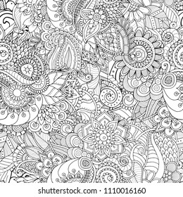 Zentangle seamless pattern with mandala elements, abstract flowers and leaves. Zendoodle texture