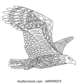 Zentangle stylized flying eagle. Hand Drawn doodle vector illustration isolated on white background. Sketch for tattoo or indian  design.
