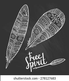 Zentangle tribal feathers set on the chalkboard.