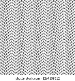Zigzag pattern from dashes and dots. Chevron fabric texture. Graphics in black and white. Vector illustration.
