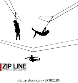 Zipline silhouette girl descend on the rope with pulley on a cable aerial ropeslide