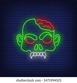 Zombie head with brains neon sign. Halloween, monster, horror design. Night bright neon sign, colorful billboard, light banner. Vector illustration in neon style.