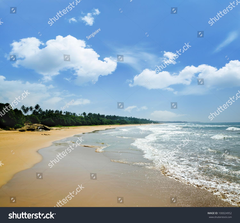 Deserted Island Beach: Sandy Deserted Beach On A Tropical Island Stock Photo