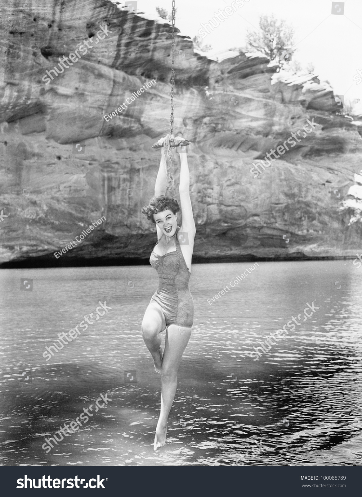 Woman hanging rope swing over water stock photo 100085789 for Swing over water