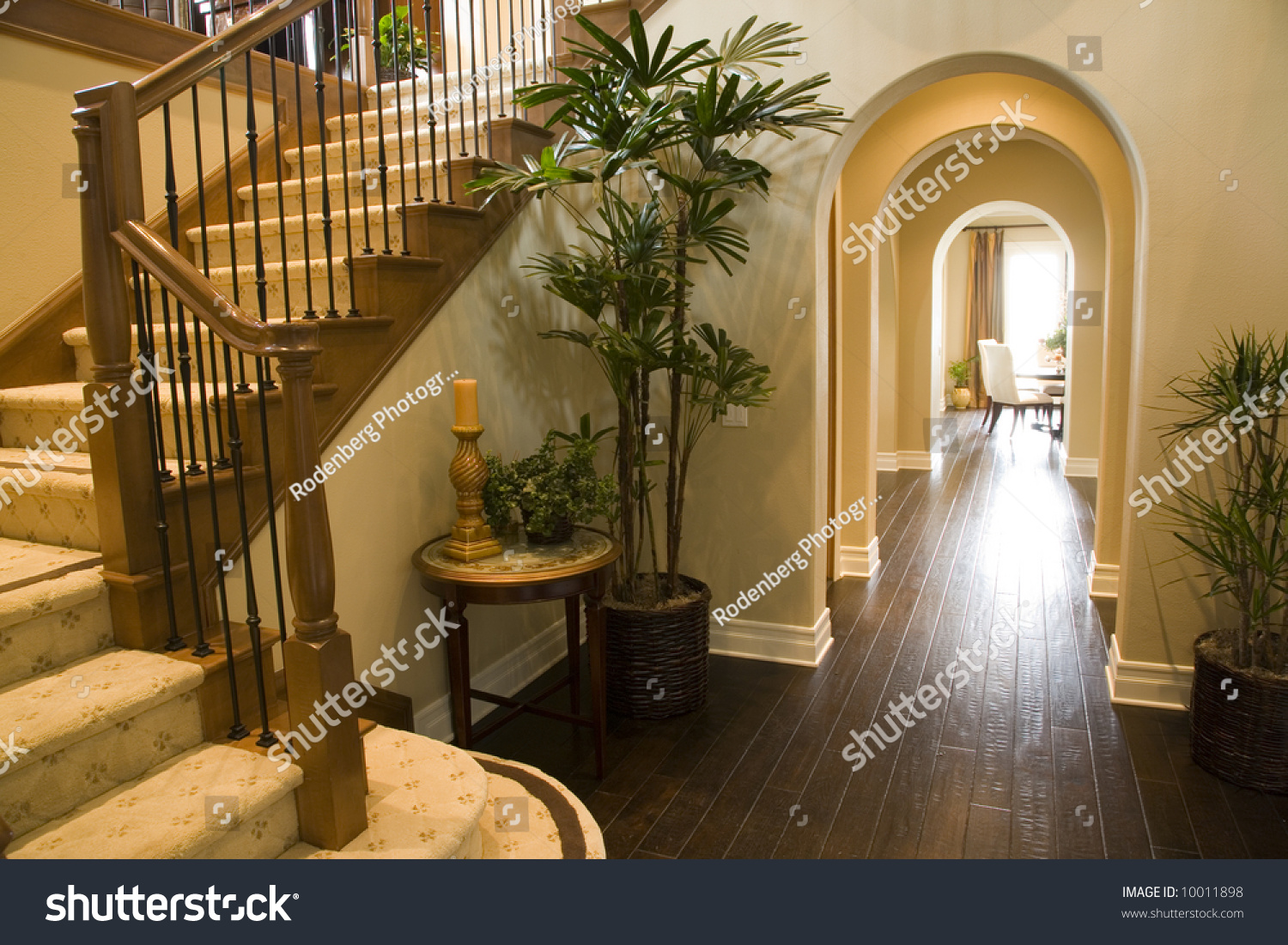 Mansion Hallway With Staircase And Luxurious Decor.