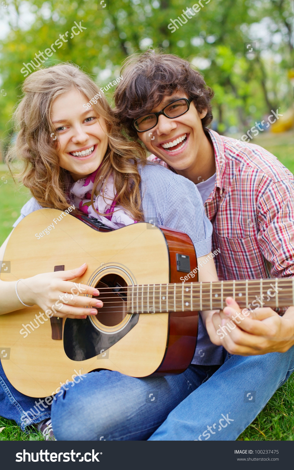 ugly guy with beautiful girl with guitar
