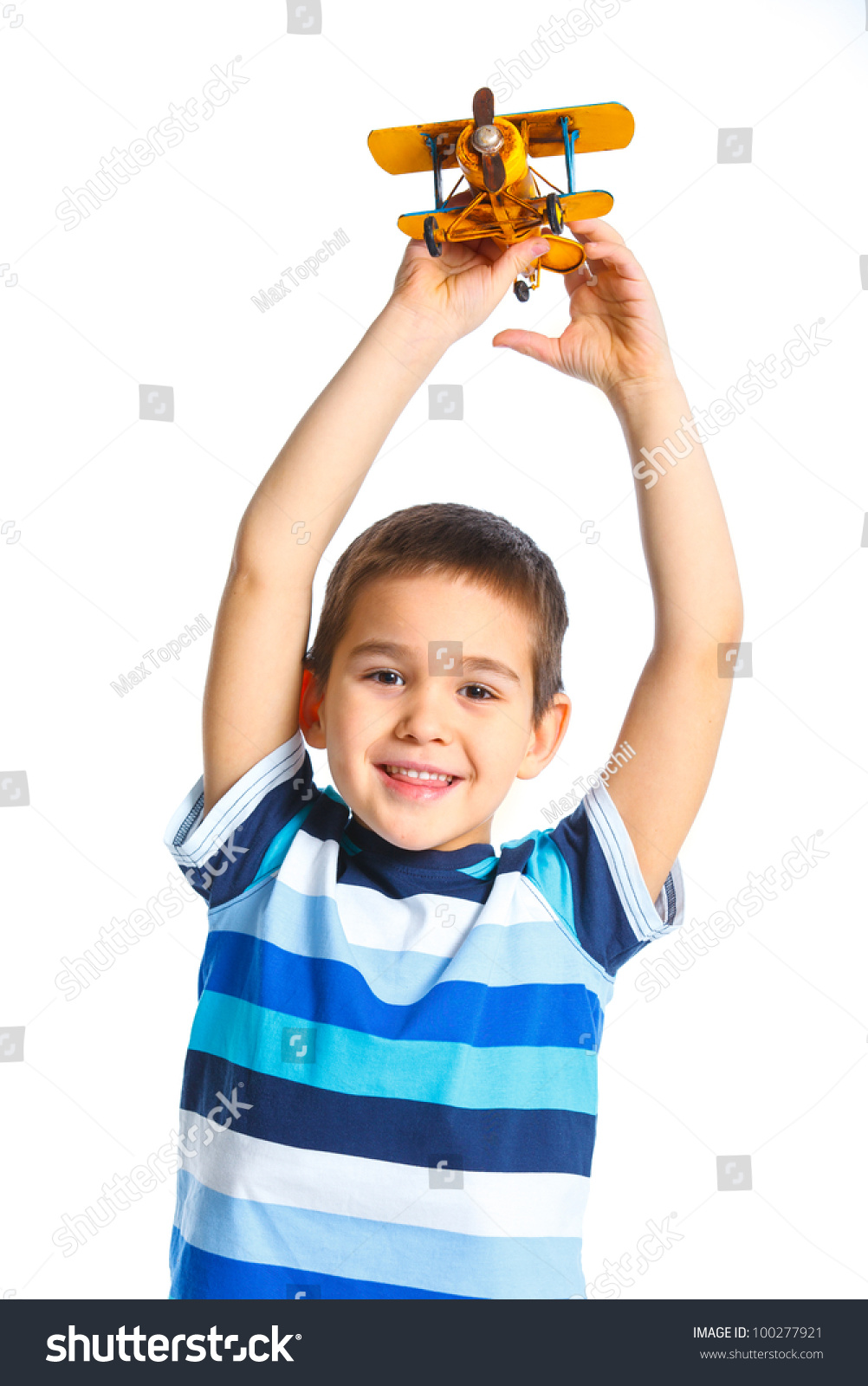 White Boys Toys : Cute little boy playing toy airplane stock photo