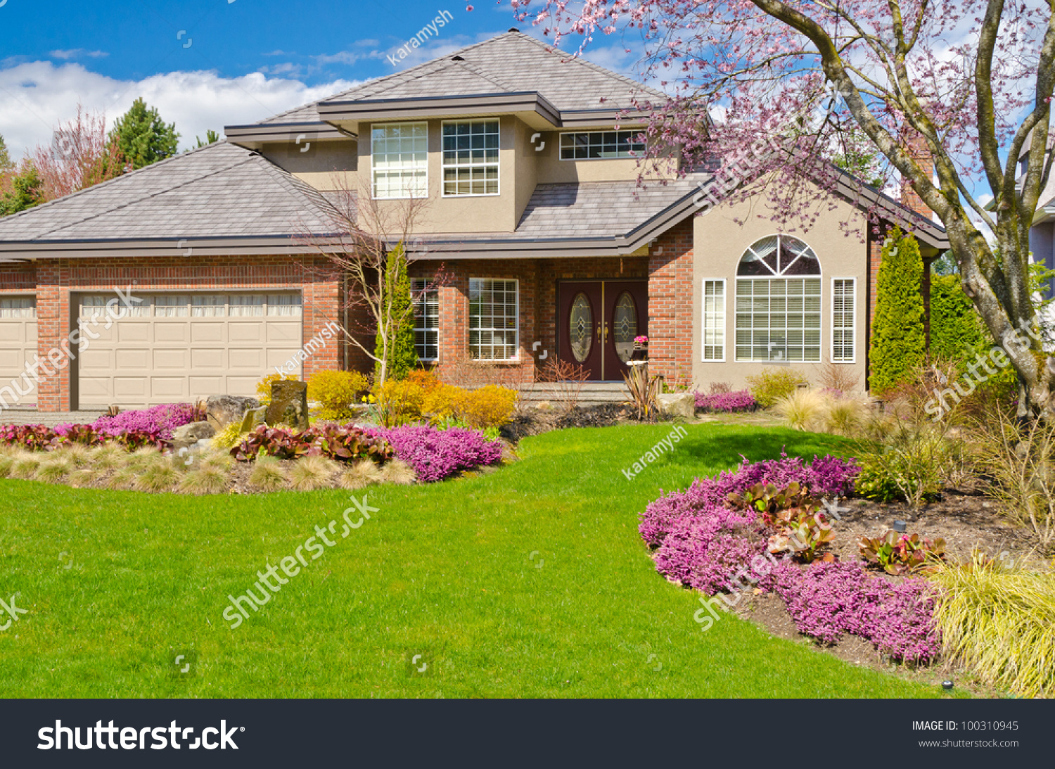 Fragment of a nice house with gorgeous lawn and outdoor for Nice houses in canada