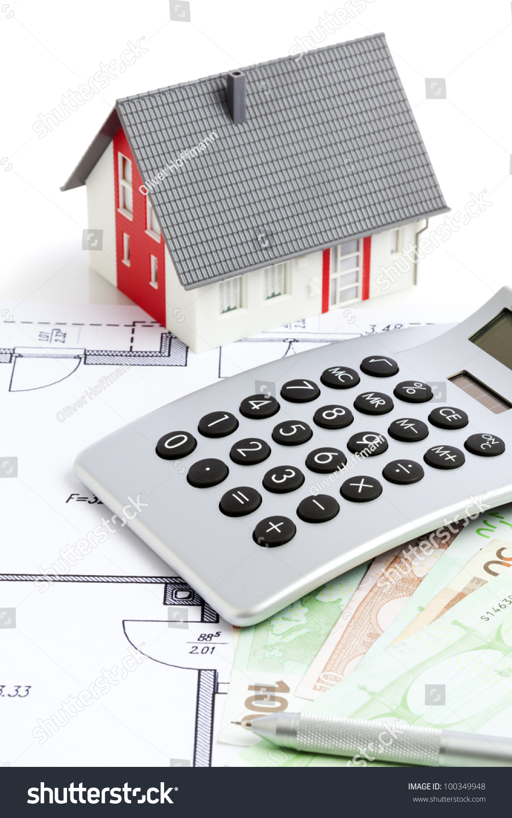 Small house calculator and money on a floor plan focus for Tiny house estimator