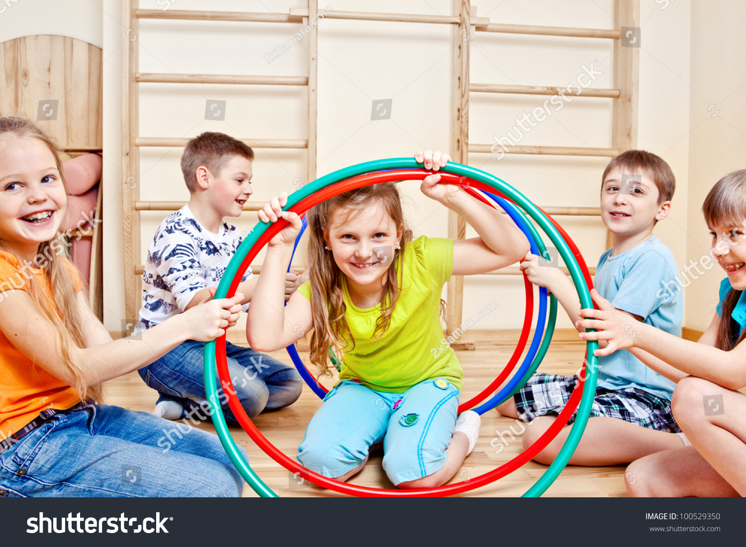 happy children holding colorful hula hoops stock photo. Black Bedroom Furniture Sets. Home Design Ideas