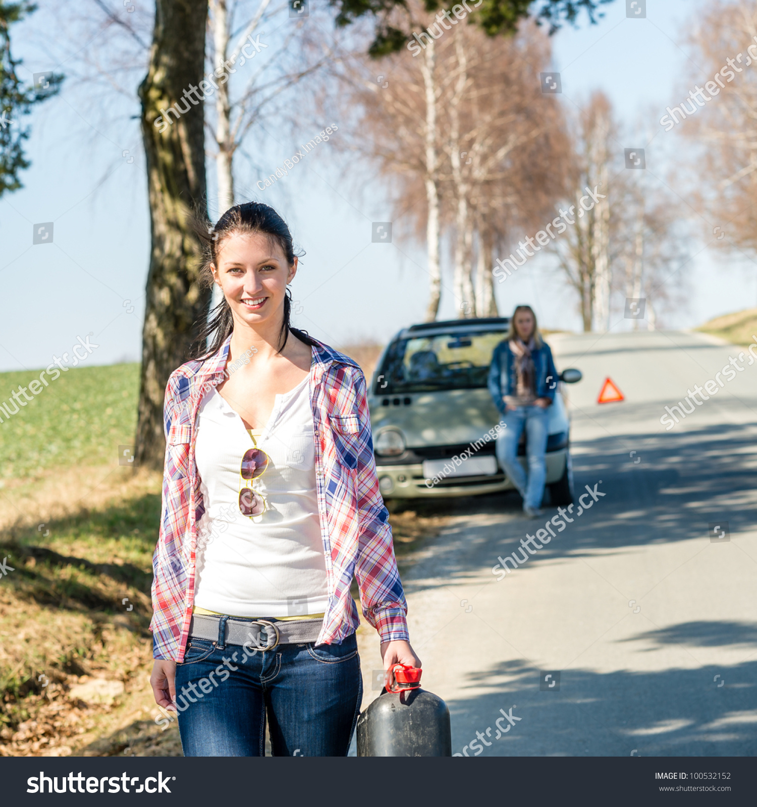 running out of gas young woman walking for petrol can stock photo 100532152 shutterstock. Black Bedroom Furniture Sets. Home Design Ideas