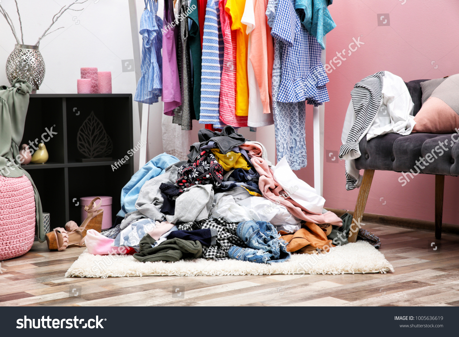 Messy dressing room interior with clothes rack #1005636619