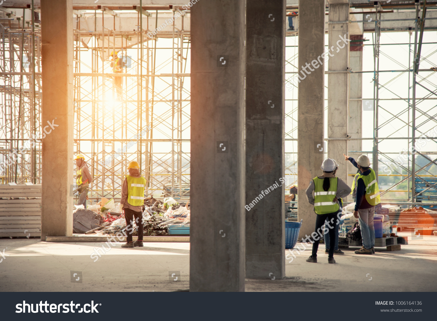 Group of construction engineer team in standard safety uniform work planing in construction site #1006164136