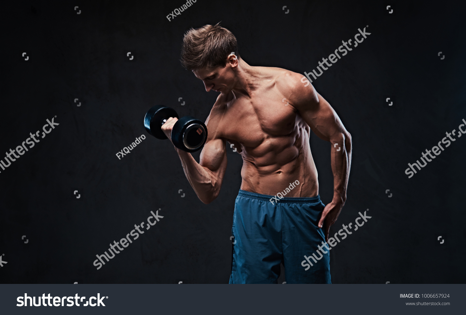 Athletic Shirtless Male Biceps Dumbbell Workout Stock Photo